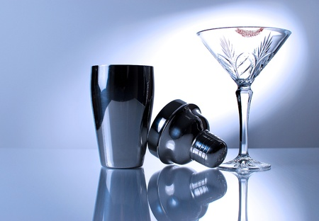 night out: Image of martini glass and mixer with reflection Stock Photo