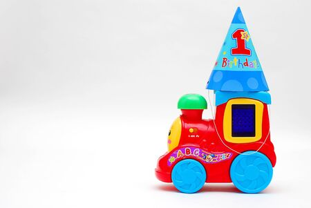 birthday party kids: First Birthday Hat on a toy train Stock Photo