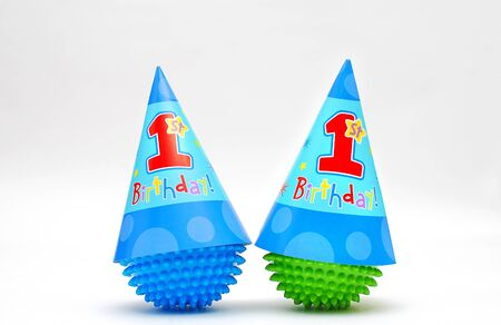 First Birthday  Hats on toy balls Stock Photo