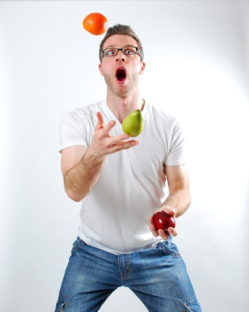 Image of a man juggling fruit