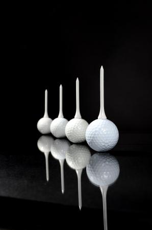 Four Balls and Four Tees Standard-Bild