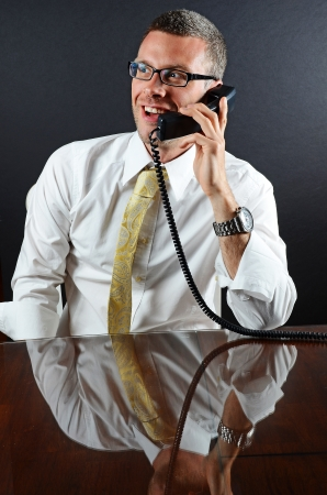firms: Image of a smiling business man on the phone