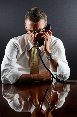 Image of a business man concentrating on the phone photo