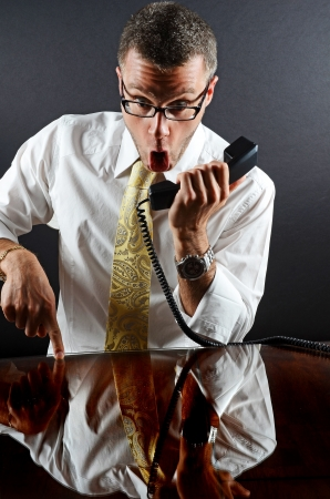 Image of a business man yelling on the phone photo