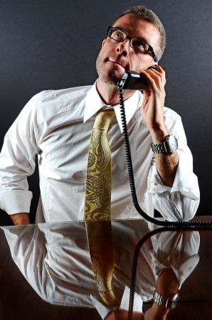 Image of a business man on the phone photo