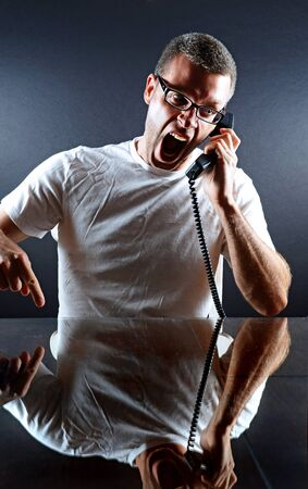 Image of a man yelling in to the phone photo