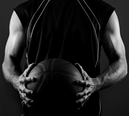 a basketball player: Image of a basketball player holding a ball