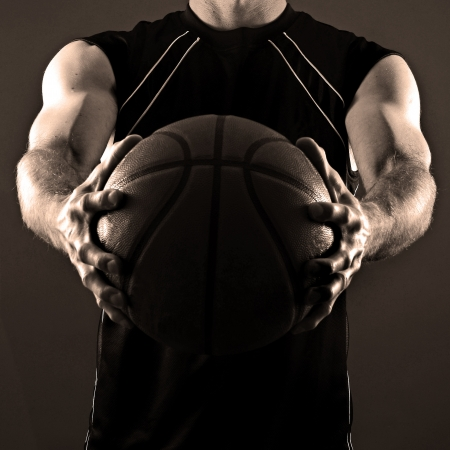 Image of a basketball player holding a ball photo