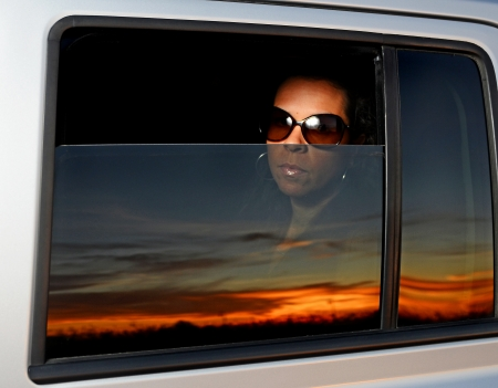 Image of an attractive female looking through a vehicle window photo