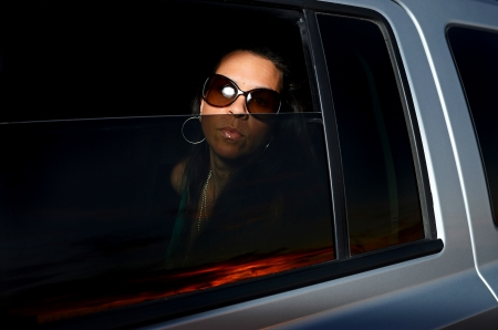 chauffeur: Image of an attractive female looking through a vehicle window Stock Photo