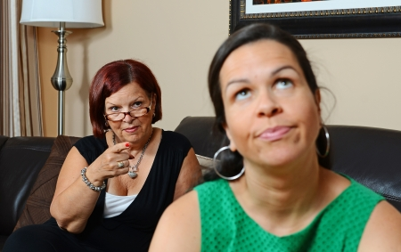 mad girl: Image of a mother looking angry at her daughter