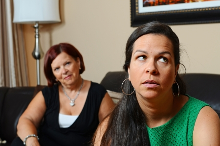 Image of a mother looking concerned for her daughter Stock Photo