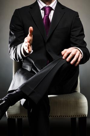 buena postura: Man Wearing Suit Handshake