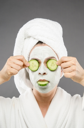 pamper: Image of a woman holding cucumbers with one in her mouth