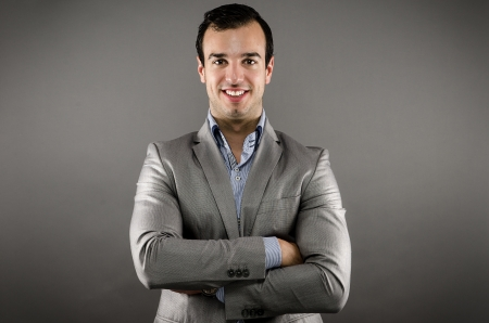 Young Man Wearing Suit with Arms Crossed