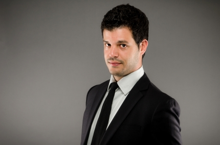 smirk: Portait of a Young Businessman