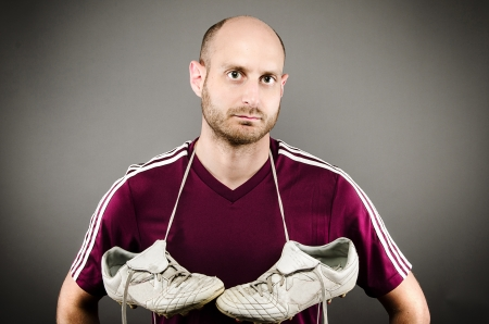 soccer cleats: Soccer Player with Cleats Hanging Around Neck
