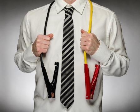 energize: Man wearing tie with jumper cables