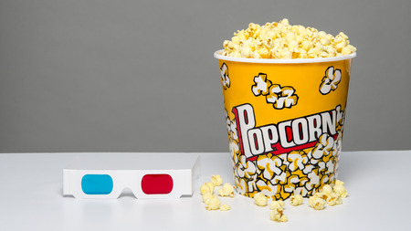 popcorn bowl: Bucket of popcorn with 3d glasses Stock Photo