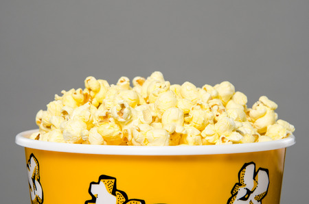 couch potato: Large bucket of popcorn