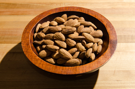 genetically modified organisms: Almonds in a bowl Stock Photo