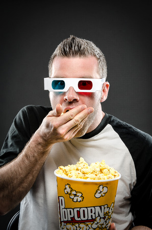 couch potato: Eating popcorn and watching movies Stock Photo