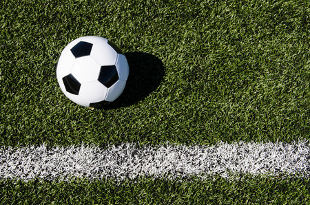 Soccer ball close to chalk photo