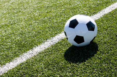 Soccer ball close to boundary Stock Photo