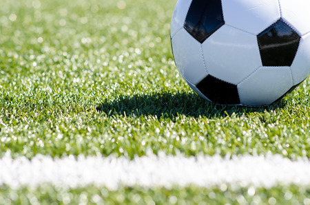 Soccer ball on field photo