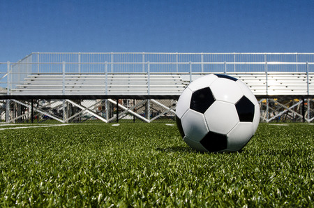 Soccer ball and stands Stock Photo