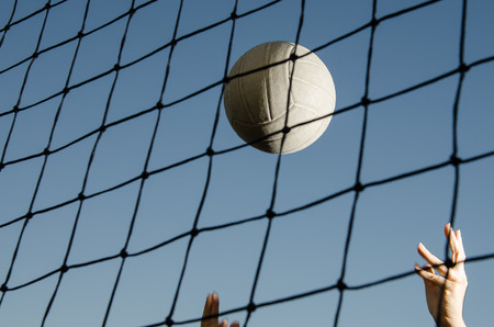 volleyball serve: Volleyball and net with hands