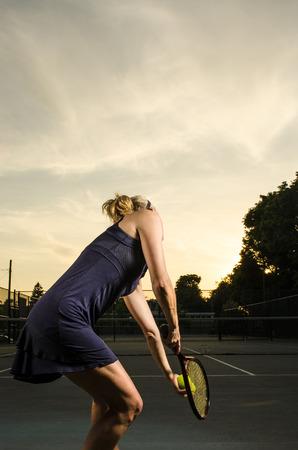 Female tennis player ready to serve photo