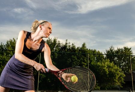 Female athlete ready to serve photo