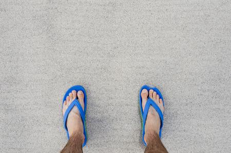 Flip Flops on the sand photo