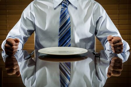 empty plate: Man with empty plate Stock Photo