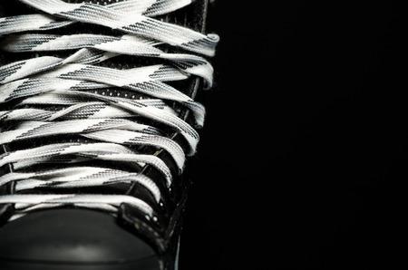 men s boot: Half of a hockey skate