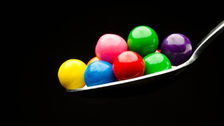 gumballs: Gumballs on a spoon