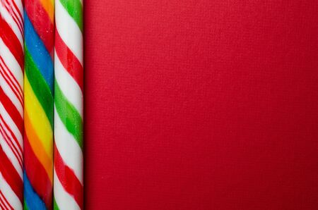 Three different candy canes on red
