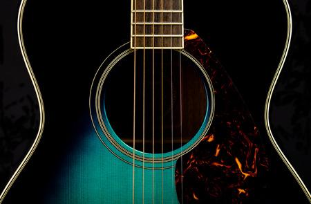 Guitar on black 스톡 콘텐츠