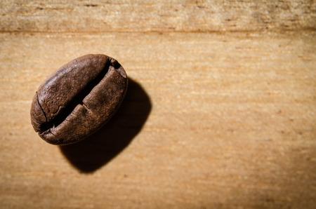 jolt: Coffee bean on wood