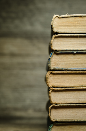 Many old books in a pile