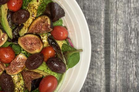 Big bowl of fresh salad on wood Stock Photo