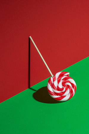 Lollipop on red and green background