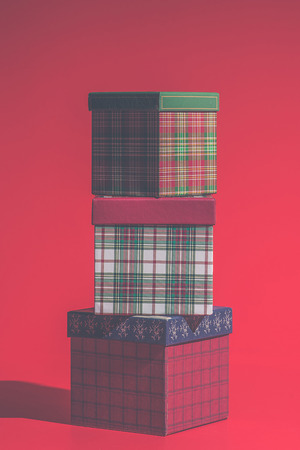 Three gift boxes on red