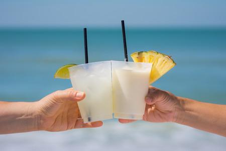 Fancy drink cheers at the beach Standard-Bild - 102173806