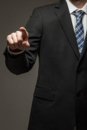 Man wearing suit pointing finger