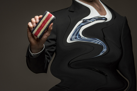 Wavy transformed man holding eraser Standard-Bild - 102941988