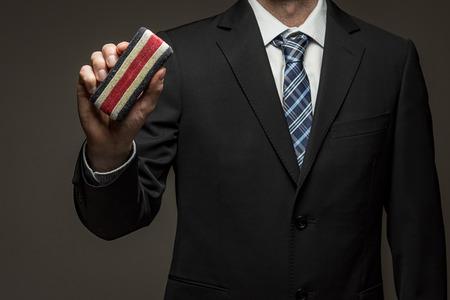 Man wearing suit holding eraser Standard-Bild