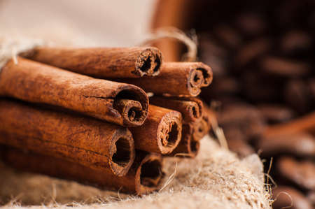 close   up: Cinnamon on wooden table
