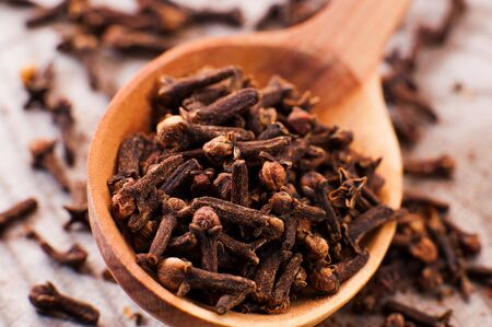 cloves: wooden spoon close-up Cloves Stock Photo